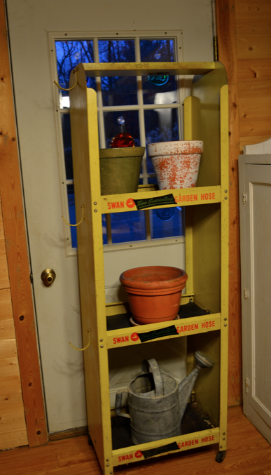 This open cabinet, which in its first life held for-sale garden hoses, was our cabinet for the outdoor kitchen this year. Now it will be pressed into service to hold indoor pots up to that lovely southern sun.